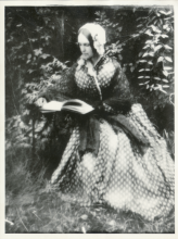 """Frances Adeline (Miller) Seward reading in the garden at her home in Auburn, New York, circa 1855-1865,"" University of Rochester Rare Books, Special Collections, and Preservation. William Henry Seward Papers: Box 100, Folder 9."